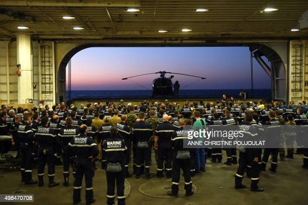 French navy soldiers wait for the arrival of French Army Chief of Staff General Pierre de Villiers aboard the French CharlesdeGaulle aircraft carrier...