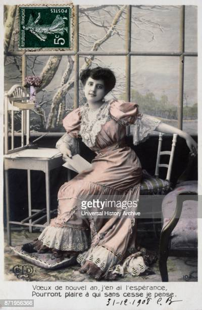 French new year postcard depicting a pensive middle class woman 1900