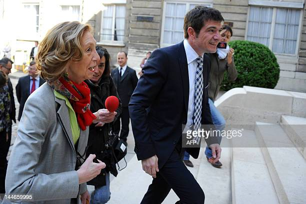 French newly appointed Minister for Ecology Sustainable Development and Energy Nicole Bricq is welcomed by former Junior Minister for Housing Benoist...