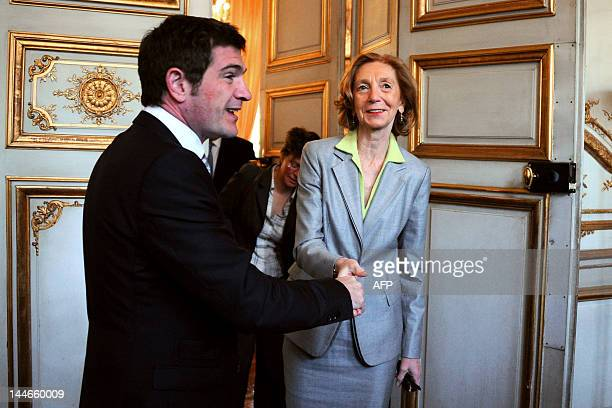 French newly appointed Minister for Ecology Sustainable Development and Energy Nicole Bricq shakes hands with former Junior Minister for Housing...