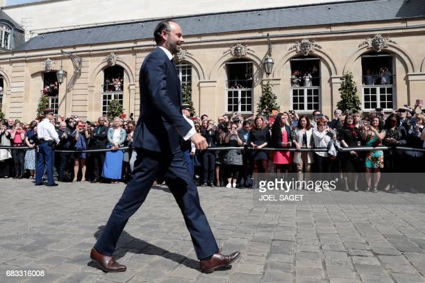 TOPSHOT French newly appointed Prime Minister Edouard Philippe arrives at the Hotel Matignon in Paris on May 15 for an official handover ceremony...