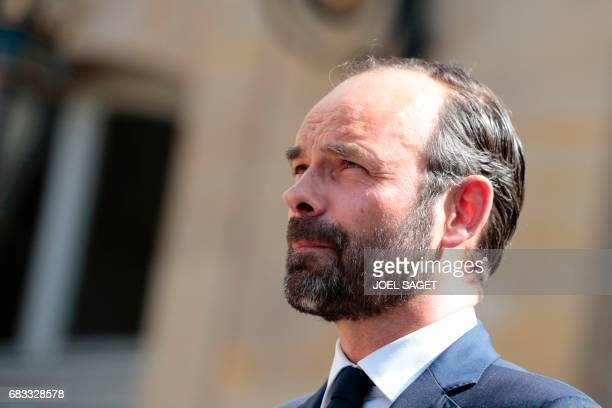 French newly appointed Prime Minister Edouard Philippe looks on during an official handover ceremony with his predecessor Bernard Cazeneuve at the...