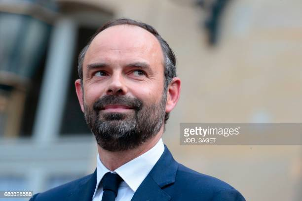 TOPSHOT French newly appointed Prime Minister Edouard Philippe looks on during an official handover ceremony with his predecessor Bernard Cazeneuve...