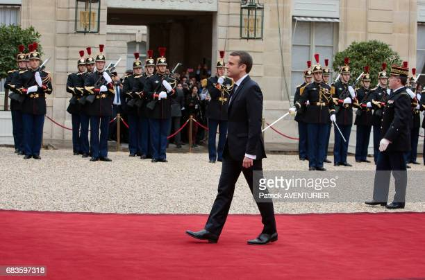 French newly elected President Emmanuel Macron poses at the Elysée presidential Palace during the handover ceremony with his predecessor François...