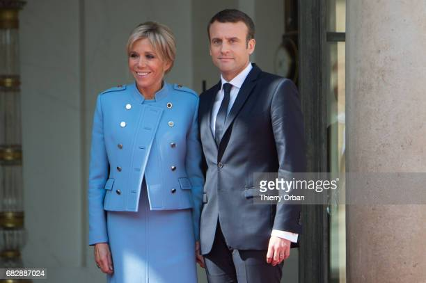 French newly elected President Emmanuel Macron poses with his Wife Brigitte Macron at the Elysee presidential Palace after the handover ceremony with...