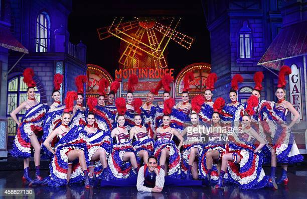 French Nicolas Pihiliangegedera poses with dancers on November 7 2014 after performing his bid to break the record of the most spinning splits in 30...