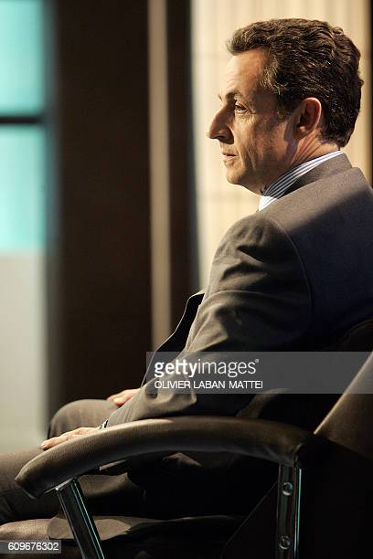 French Nicolas Sarkozy right wing party Union for a Popular Movement candidate for France's presidential election participates to the recording of a...
