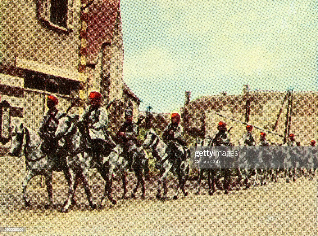 French north African troops on horse Caption reads renowned for their endurance and skill with weapons Cigarette cards published in Germany c1934...