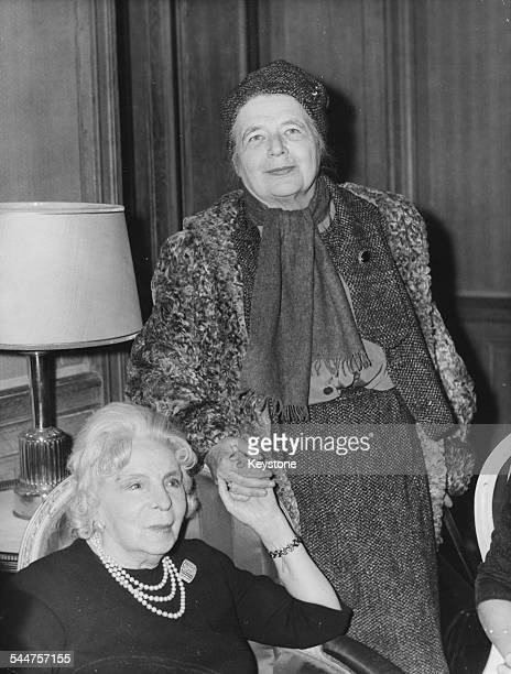 French novelist Marguerite Yourcenar winner of the Prix Femina Prize holding hands with Madame Simone a member of the jury 1968