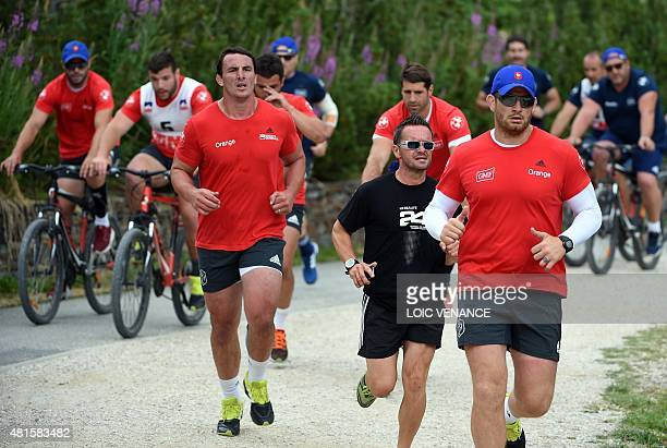 French number 8 Louis Picamoles and lock Pascal Pape take part in a 'Run and Bike' session as part of the French rugby union team's training camp in...