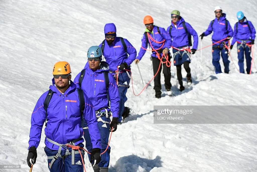 French number eight Damien Chouly French flanker Thierry Dusautoir and their other teammates walk down the Grande Motte glacier during the French...