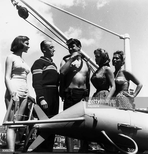 French oceanographer Jacques Cousteau hosts a party on board his research vessel 'Calypso' before the showing of George Clouzot's film 'Le Monde Du...