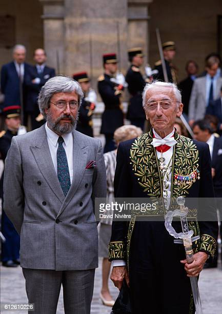 French oceanogrpaher JeanMichel Cousteau and his father JacquesYves Cousteau during a reception at the 'Académie Française'