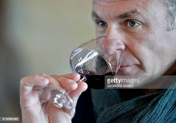 French oenologist Stéphane Toutoumoudji tastes a wine at the Chateau Haut Sarpe in SaintEmilion on April 5 2016 The 'primeurs' week of the...
