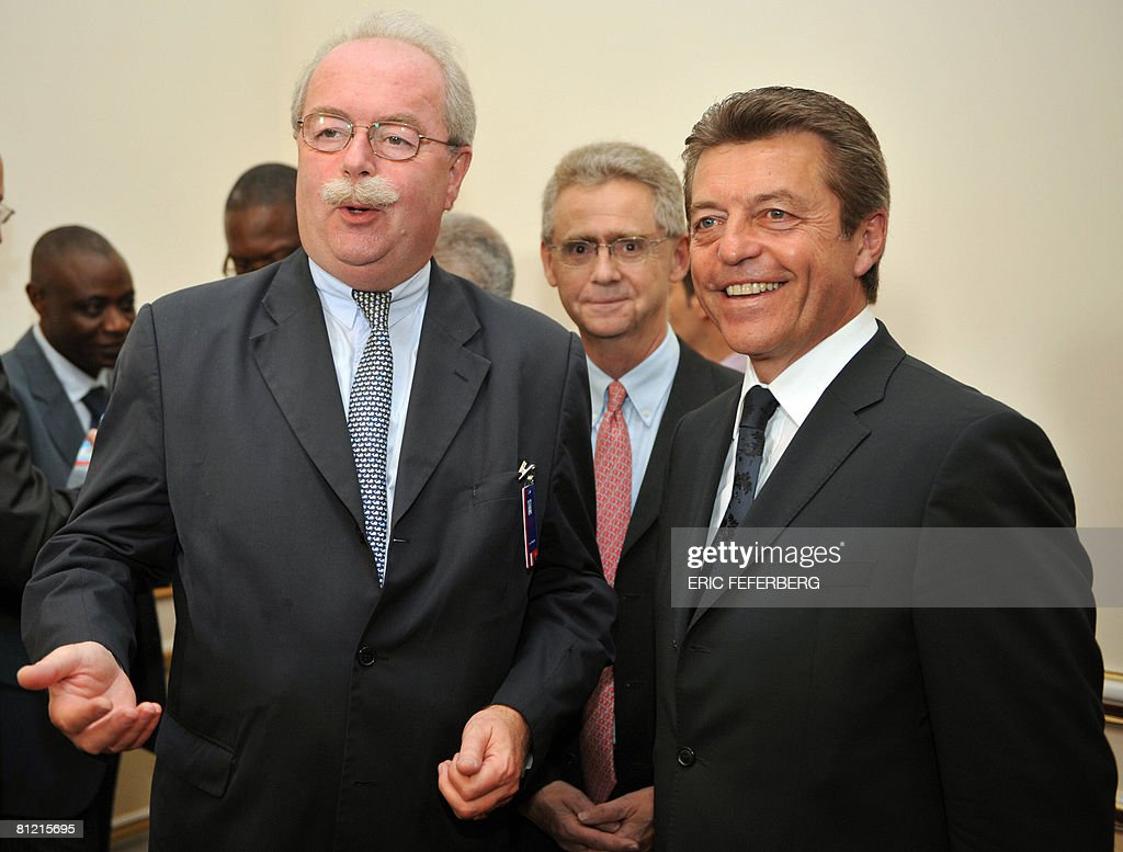French oil company Total CEO <a gi-track='captionPersonalityLinkClicked' href=/galleries/search?phrase=Christophe+de+Margerie&family=editorial&specificpeople=2624113 ng-click='$event.stopPropagation()'>Christophe de Margerie</a> (L) shares a smile with Secretary of State for Cooperation and Francophony Alain Joyandet (R) after Total signed an agreement to built four high schools in Angola on May 23, 2008, during a ceremony held in Luanda Presidential palace. French President Nicolas Sarkozy met earlier with his Angolese counterpar Jos? Eduardo Dos Santos.