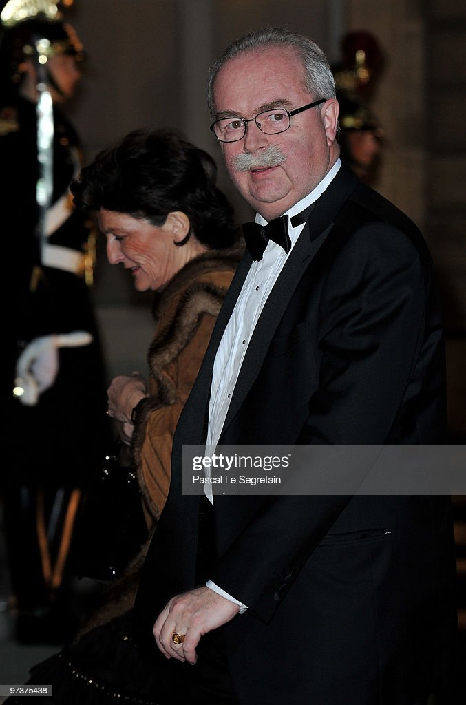 French oil giant Total chief executive <a gi-track='captionPersonalityLinkClicked' href=/galleries/search?phrase=Christophe+de+Margerie&family=editorial&specificpeople=2624113 ng-click='$event.stopPropagation()'>Christophe de Margerie</a> (R) arrives with his wife to attend a state dinner honouring visiting Russian President Dmitry Medvedev at Elysee Palace on March 2, 2010 in Paris, France.