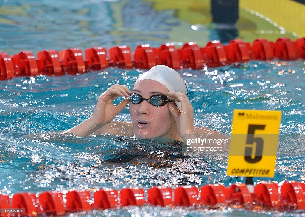 French Olympic champion Camille Muffat removes her goggles on November 24, 2012 after the women's 400m freestyle series at the European Swimming Championships in the central French city of Chartres. FEFERBERG
