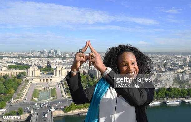 French Olympic Champion Laura FlesselColovic poses at the Eiffel Tower on May 16 in front of the proposed venues for open water swimming triathlon...