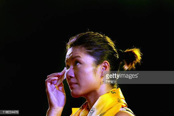 French Open champion Li Na wipes the tears during an celebration event with her fans organized by Women Tennis Association on July 5 2011 in Beijing...