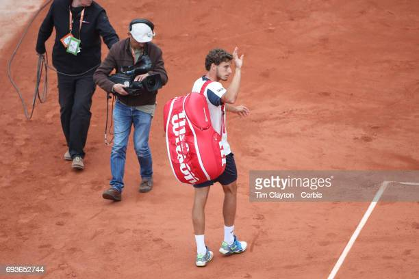 French Open Tennis Tournament Day Eleven Pablo Carreno Busta of Spain leaves the stadium after retiring against Rafael Nadal of Spain in action in...