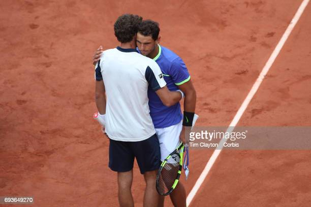 French Open Tennis Tournament Day Eleven Rafael Nadal of Spain embraces Pablo Carreno Busta of Spain who retired in the second set in the Men's...