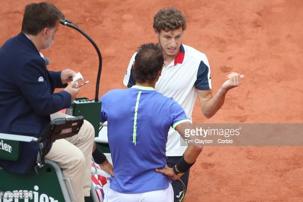 French Open Tennis Tournament Day Eleven Rafael Nadal of Spain with Pablo Carreno Busta of Spain who retired in the second set in the Men's Singles...