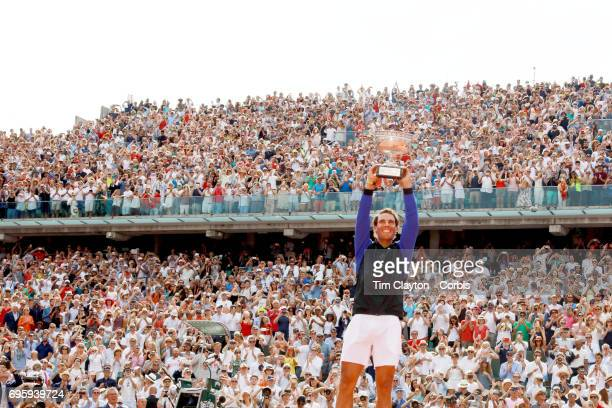 French Open Tennis Tournament Day Fifteen Rafael Nadal of Spain with the trophy in front of an amazing back drop of fans at Roland Garros after...