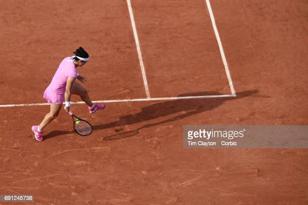 French Open Tennis Tournament Day Four Ons Jabeur of Tunisia plays a shot through her legs during her victory over Dominika Cibulkova of Slovakia in...