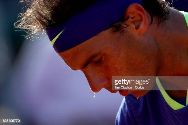 French Open Tennis Tournament Day Thirteen Sweat drops from the nose of Rafael Nadal of Spain as he prepares to serve against Dominic Thiem of...
