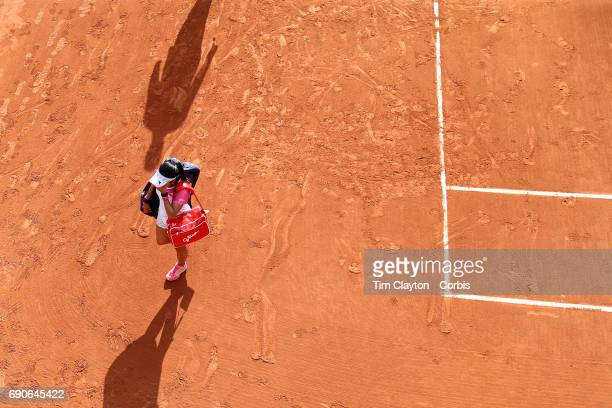French Open Tennis Tournament Day Three Risa Ozaki of Japan leaves the arena after her loss to Eugenie Bouchard of Canada during the Women's Singles...