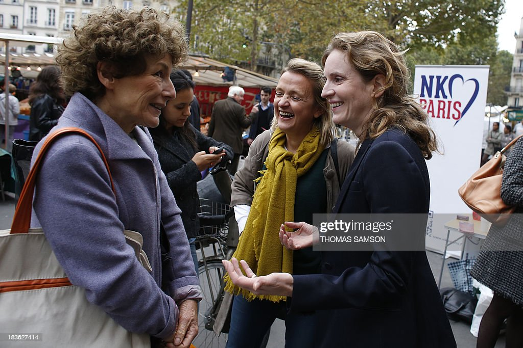 French opposition right-wing UMP (Union for a Popular Movement) candidate for mayor of Paris in the March 2014 election, Nathalie Kosciusko-Morizet (R), visits a market on October 8, 2013 in Paris with the candidate for mayor of the 5th district, Florence Berthout (C), whom Kosciusko-Morizet supports ahead of the upcoming elections.