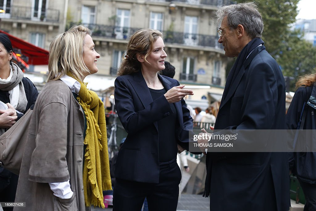 French opposition right-wing UMP (Union for a Popular Movement) candidate for mayor of Paris in the March 2014 election, Nathalie Kosciusko-Morizet (C), visits a market on October 8, 2013 in Paris with the candidate for mayor of the 5th district, Florence Berthout (L), whom Kosciusko-Morizet supports ahead of the upcoming elections.