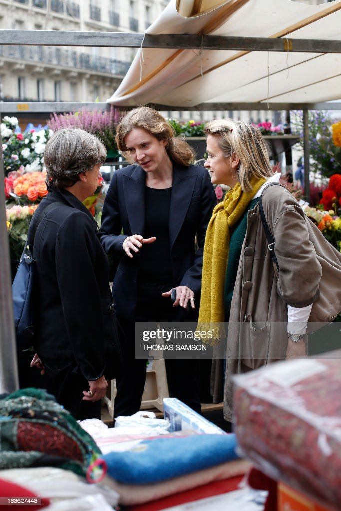 French opposition right-wing UMP (Union for a Popular Movement) candidate for mayor of Paris in the March 2014 election, Nathalie Kosciusko-Morizet (C), visits a market on October 8, 2013 in Paris with the candidate for mayor of the 5th district, Florence Berthout (R), whom Kosciusko-Morizet supports ahead of the upcoming elections.