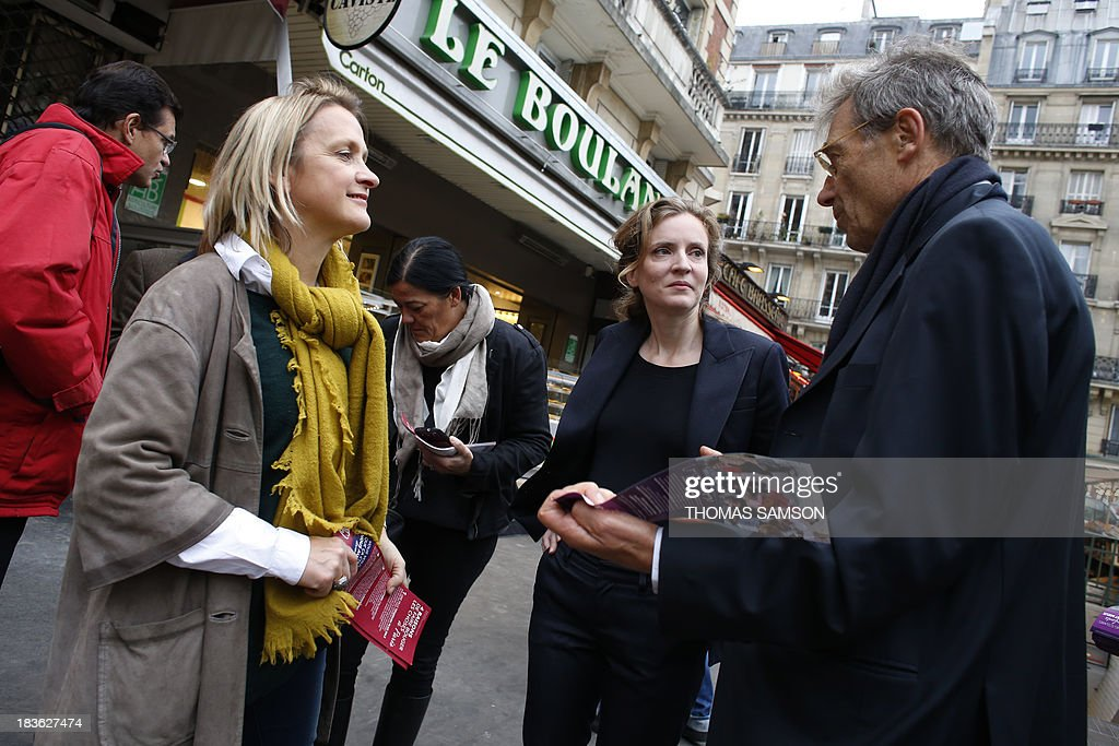 French opposition right-wing UMP (Union for a Popular Movement) candidate for mayor of Paris in the March 2014 election, Nathalie Kosciusko-Morizet (2R), visits a market on October 8, 2013 in Paris with the candidate for mayor of the 5th district, Florence Berthout (L), whom Kosciusko-Morizet supports ahead of the upcoming elections.