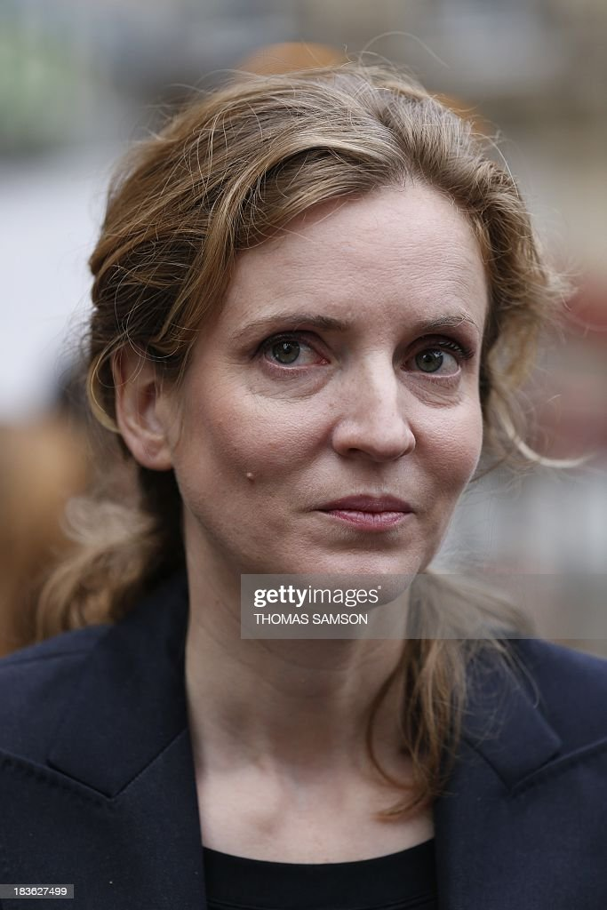 French opposition right-wing UMP (Union for a Popular Movement) candidate for mayor of Paris in the March 2014 election, Nathalie Kosciusko-Morizet, visits a market on October 8, 2013 in Paris.