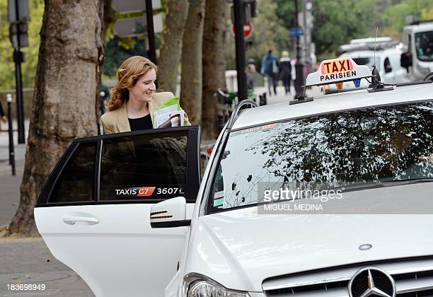 French opposition rightwing UMP candidate for the March 2014 mayoral elections in Paris Nathalie KosciuskoMorizet gets in a cab on October 9 after a...