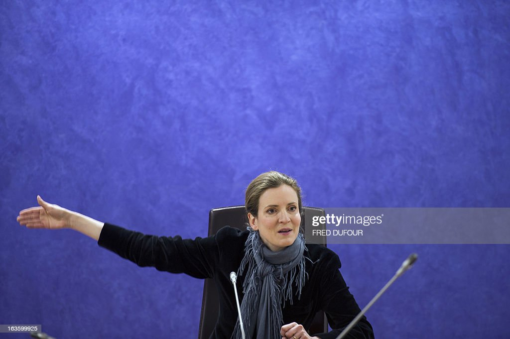 French opposition right-wing UMP party member and former French environment minister Nathalie Kosciusko-Morizet gestures as she gives a press conference focused on education, on March 13, 2013 in Paris.