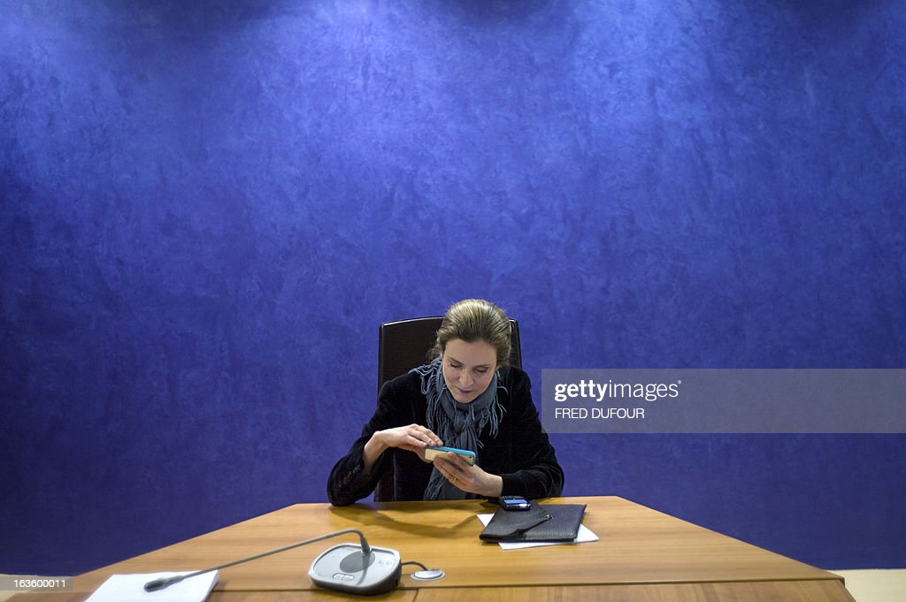 French opposition right-wing UMP party member and former French environment minister Nathalie Kosciusko-Morizet looks at her cell phone during a press conference focused on education, on March 13, 2013 in Paris.