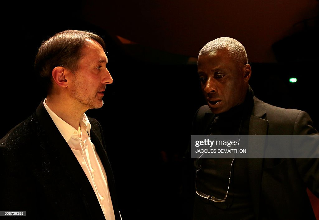 French organist Olivier Latry (G) and English organist Wayne Marshall (D) talk during the inauguration of the new organ at 'La Philarmonie de Paris' on February 6, 2016. The 'Philarmonie de Paris' organises during the February 6 and 7 weekend concerts, cine-concert, visits, workshops dedicated to its new organ conceived by French musician and organist builder Michel Garnier for Austrian firm Rieger. / AFP / JACQUES DEMARTHON