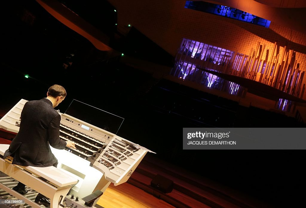 French organist Olivier Latry plays during the inauguration of the new organ at 'La Philarmonie de Paris' on February 6, 2016, in Paris. The 'Philarmonie de Paris' organises during the February 6 and 7 weekend concerts, cine-concert, visits, workshops dedicated to its new organ conceived by French musician and organist builder Michel Garnier for Austrian firm Rieger. / AFP / JACQUES DEMARTHON