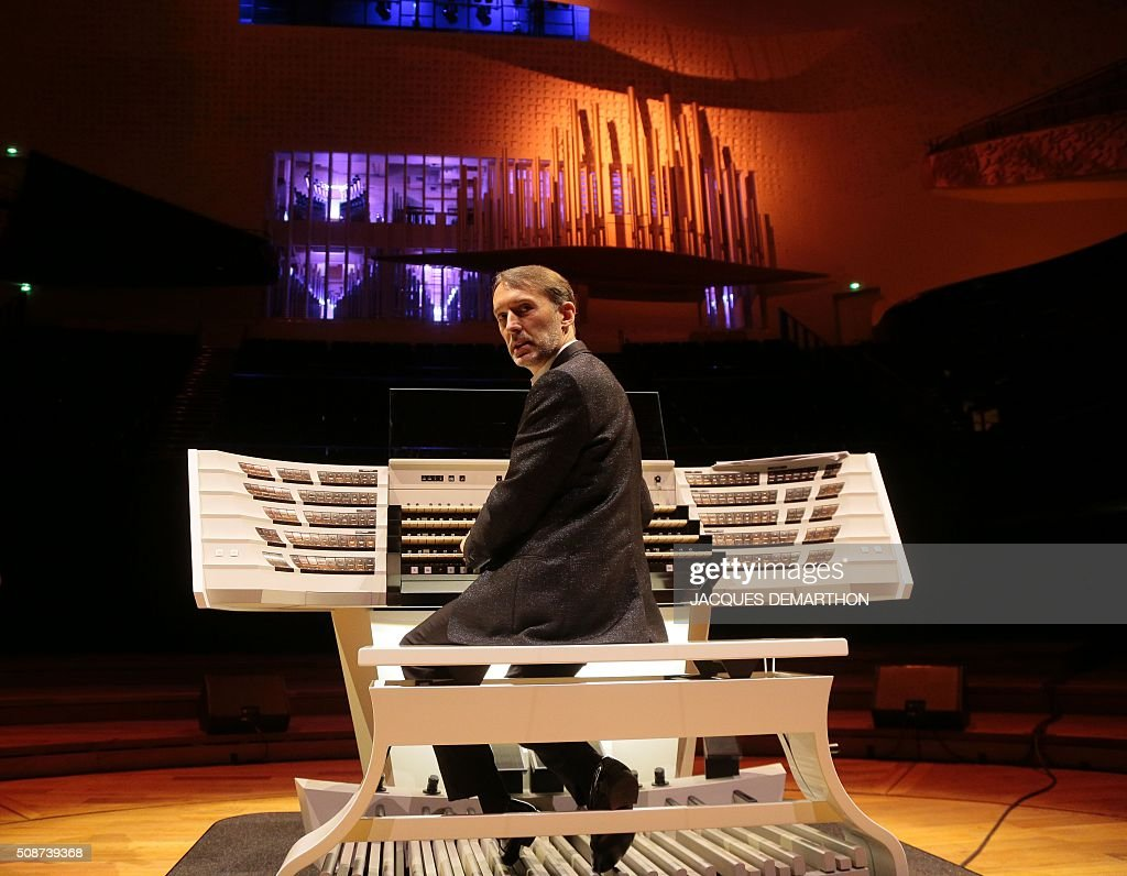 French organist Olivier Latry poses during the inauguration of the new organ at 'La Philarmonie de Paris' on February 6, 2016, in Paris. The 'Philarmonie de Paris' organises during the February 6 and 7 weekend concerts, cine-concert, visits, workshops dedicated to its new organ conceived by French musician and organist builder Michel Garnier for Austrian firm Rieger. / AFP / JACQUES DEMARTHON