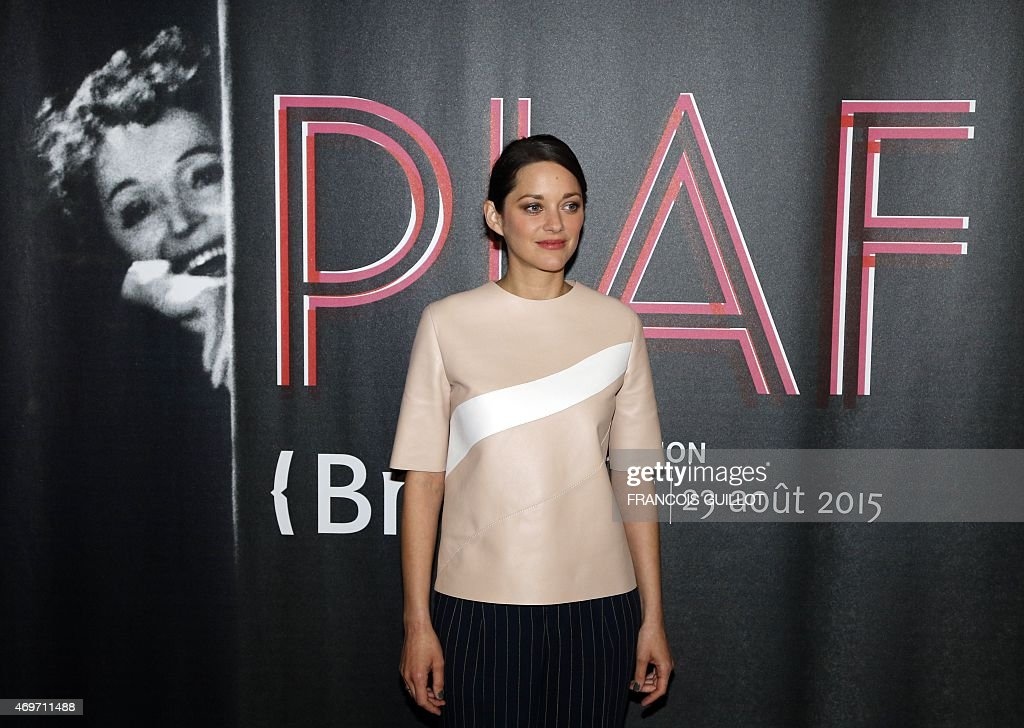French Oscar-winning actress <a gi-track='captionPersonalityLinkClicked' href=/galleries/search?phrase=Marion+Cotillard&family=editorial&specificpeople=215303 ng-click='$event.stopPropagation()'>Marion Cotillard</a> poses during the opening of the exhibition 'Piaf', dedicated to France's legendary singer Edith Piaf, on April 14, 2015 at the BNF in Paris. The exhibition, running through April 14 - August 23, 2015, begins the start of commemorations marking the centenary of the singer's birth in 1915.