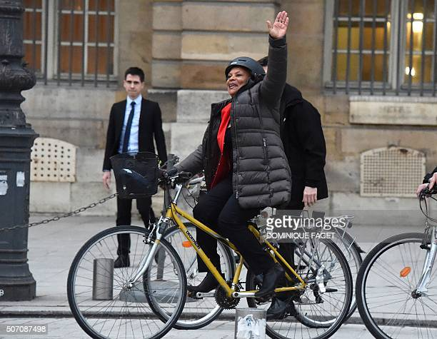 TOPSHOT French outgoing Justice Minister Christiane Taubira waves as she leaves on a bike the French Justice Ministry in Paris on January 27...