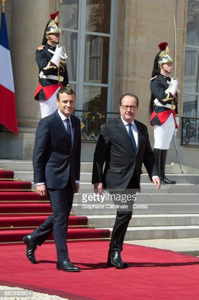 French outgoing President Francois Hollande leaves the Elysee presidential Palace at the end of the handover ceremony with newly elected French...