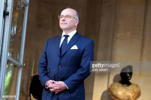 French outgoing Prime Minister Bernard Cazeneuve stands guard at the entrance of the Hotel Matignon in Paris on May 15 as he waits for his successor...