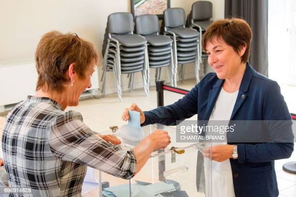 French Overseas Minister Annick Girardin arrives to cast her vote into a ballot box at a polling station in SaintPierre in the French overseas...