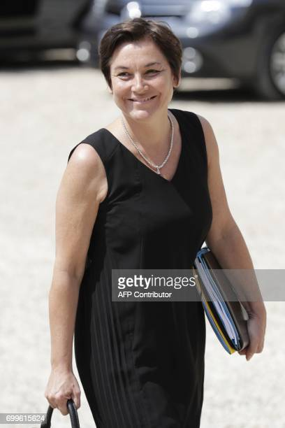 French Overseas Minister Annick Girardin leaves the Elysee Palace in Paris after the first cabinet meeting of the French new government on June 22...
