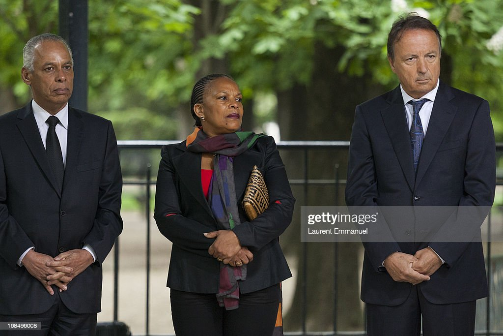 French Overseas Minister Victorin Lurel, French Justice Minister Christiane Taubira and President of the French Senate Jean-Pierre Bel listen to the speech of French President Francois Hollande during a ceremony marking the abolition of slavery in the Jardins du Luxembourg on May 10, 2013 in Paris, France. Taubira Law was passed in May 2001 acknowledging slavery and the Atlantic slave trade as crimes against humanity.