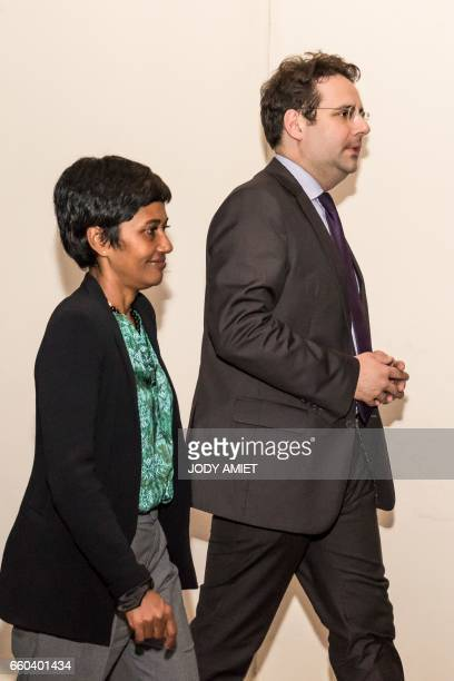 French Overseas Territories Minister Ericka Bareigts and French Interior Minister Matthias Fekl leave after holding a joint press conference on March...