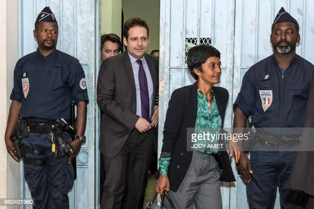 French Overseas Territories Minister Ericka Bareigts and French Interior Minister Matthias Fekl leave the prefecture building after holding a joint...